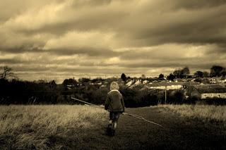 alone boy walking