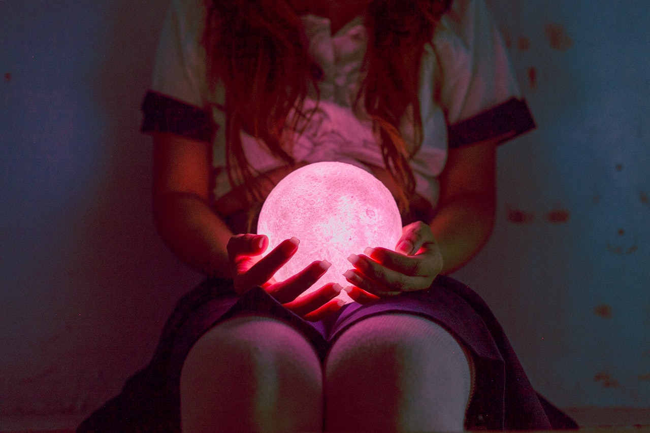 person holding light ball