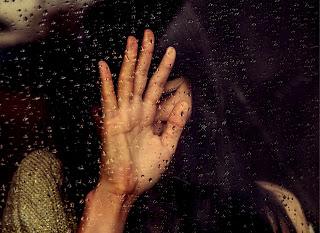 sad girl alone in rain