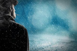 man standing alone in rain